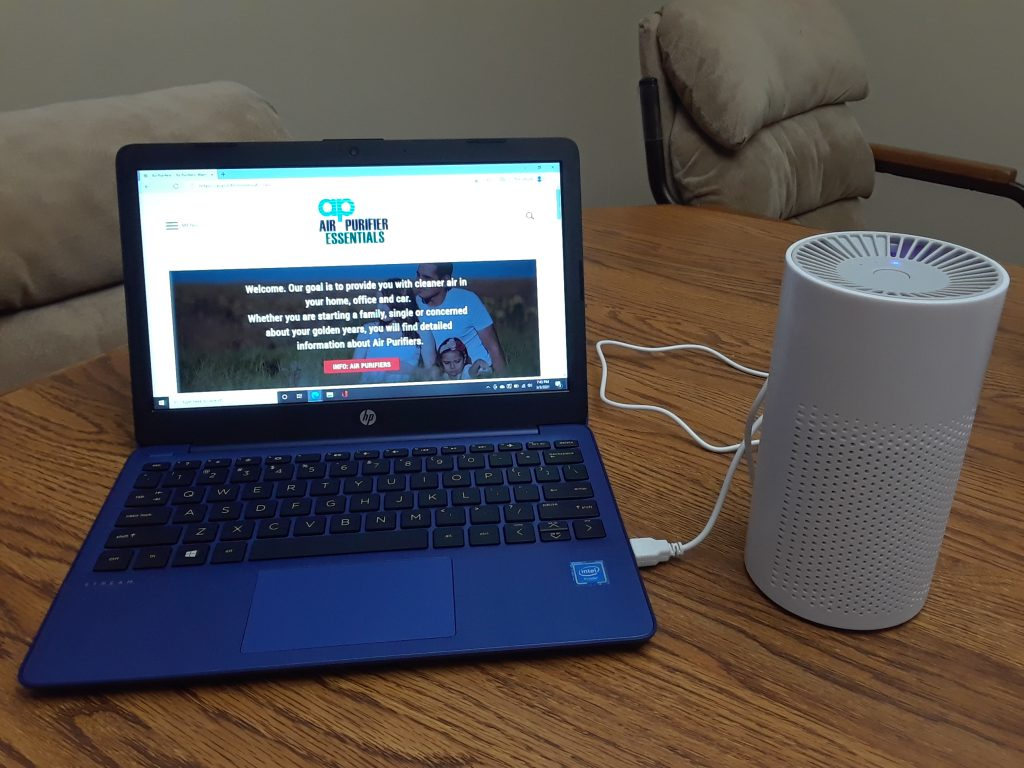 You can use your laptop as a power source for a personal air purifier
